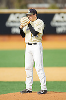 Wake Forest Demon Deacons starting pitcher Max Tishman (34) looks to his catcher for the sign against the Marshall Thundering Herd at Wake Forest Baseball Park on February 17, 2014 in Winston-Salem, North Carolina.  The Demon Deacons defeated the Thundering Herd 4-3.  (Brian Westerholt/Four Seam Images)