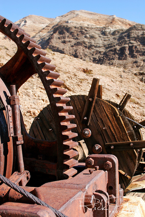 Abandoned machinery at the Keane Wonder Mine in Death Valley National Park. The Keane Wonder mine was one of the two largest producing gold mines in the Death Valley area. The total production of the mine during its operation was estimated at $1,100,000. Of that amount, $625,000-$682,000 worth of gold was taken from the mine between 1907-1911.