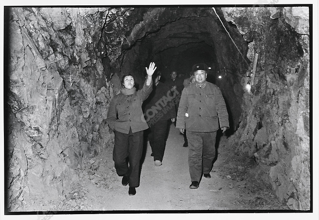 """Iron Woman"" Guo Fenglian, the national model worker and Party branch secretary of Dazhai Commune, Shanxi Province, visits an air raid shelter project at Mudanjiang City, Heilongjiang Province, March 17, 1973"