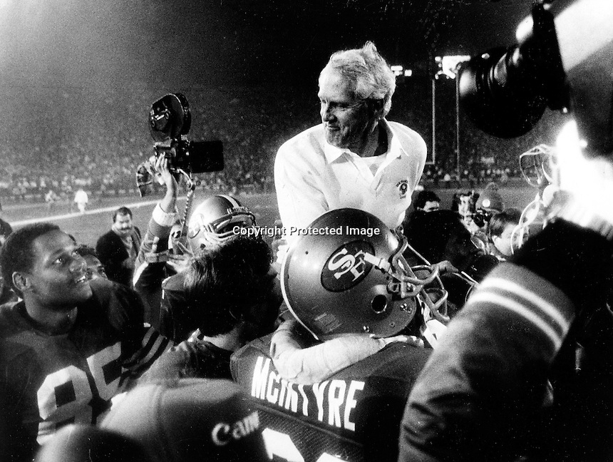 Victorious San Francisco 49ers carry a beaming coach Bill Walsh after they rolled over the Miami Dolphins 38-16 to win Super Bowl XIX at Stanford Stadium. Jan 20, 1985. (photo by Ron Riesterer)