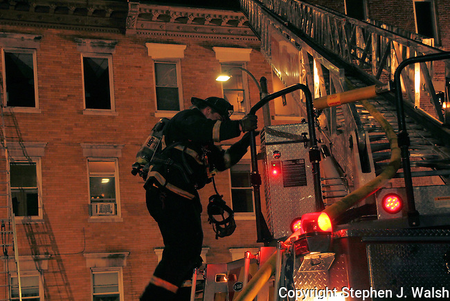 4 alarm fire at 26 Cooper Street in Boston' North End. One woman seriously burned. Boston Box 1212 23:05pm