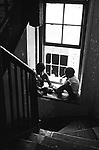 Children playing in the stairway of a building that houses families who are mostly living on welfare tenements that are side by side with more affluent buildings along the boardwalk in Long Beach, Ny in 1969.