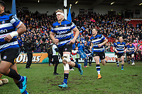 Tom Ellis and the rest of the Bath Rugby team run onto the field. Anglo-Welsh Cup Final, between Bath Rugby and Exeter Chiefs on March 30, 2018 at Kingsholm Stadium in Gloucester, England. Photo by: Patrick Khachfe / Onside Images