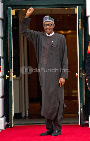 Muhammadu Buhari, President of the Federal Republic of Nigeria arrives for the working dinner for the heads of delegations at the Nuclear Security Summit on the South Lawn of the White House in Washington, DC on Thursday, March 31, 2016.<br /> Credit: Ron Sachs / Pool via CNP/MediaPunch