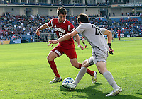 HOOVER, AL - DECEMBER 09, 2012: Matt McKain (5) of Indiana University defends against Andy Riemer (20) of Georgetown University during the NCAA 2012 Men's College Cup championship, at Regions Park, in Hoover , AL, on Sunday, December 09, 2012.