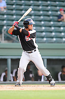 Catcher Jorge Alfaro (11) of the Hickory Crawdads bats in a game against the Greenville Drive on Friday, June 7, 2013, at Fluor Field at the West End in Greenville, South Carolina. Alfaro is the No. 9 prospect of the Texas Rangers, according to Baseball America. Greenville won the resumption of this May 22 suspended game, 17-8. (Tom Priddy/Four Seam Images)
