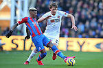 Crystal Palace's Patrick van Aanholt and Sheffield United's Sander Berge challenge for the ball during the Premier League match at Selhurst Park, London. Picture date: 1st February 2020. Picture credit should read: Paul Terry/Sportimage