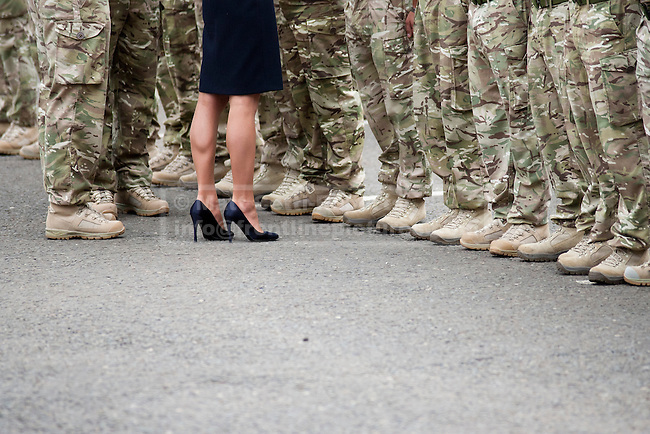WINDSOR, UK  25/06/11. The footwear of the Duchess of Cambridge contrasts with that worn by Guardsmen during a medals parade. The First Battalion, The Irish Guards, recently returned from operation Herric in Afghanistan, were parading at their current base, Victoria Barracks, in Windsor to receive the Afghanistan Campaign Medal from the Duke and Duchess of Cambridge. Photo credit should read Matt Cetti-Roberts