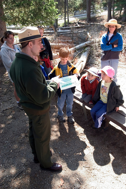 WY: Wyoming, Yellowstone National Park:.Ranger instructing children.  .Photo #: yellow1112..Photo copyright Lee Foster, 510/549-2202, lee@fostertravel.com, www.fostertravel.com..