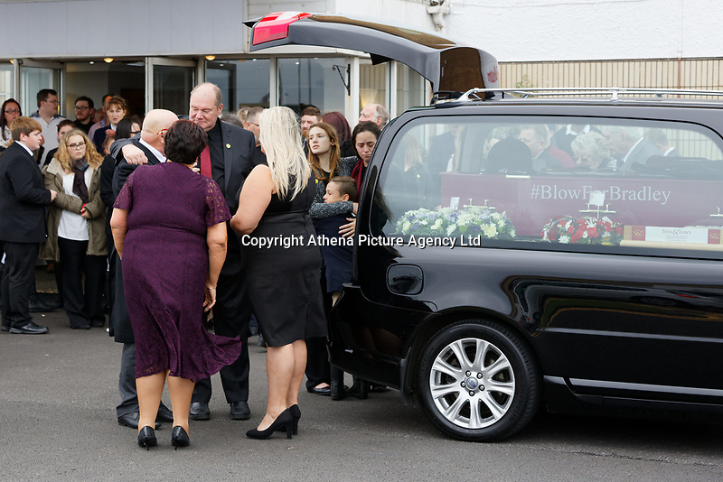 "Pictured: Byron John (3rd L) the father of Bradley and sister Danielle (BACKGROUND) greet mourners at Aberavon Beach Hotel in Port Talbot, Wales, UK. Monday 08 October 218<br /> Re: A grieving father will mourners on horseback at the funeral of his ""wonderful"" son who killed himself after being bullied at school.<br /> Talented young horse rider Bradley John, 14, was found hanged in the school toilets by his younger sister Danielle.<br /> Their father, farmer Byron John, 53, asked the local riding community to wear their smart hunting gear at Bradley's funeral.<br /> Police are investigating Bradley's death at the 500-pupils St John Lloyd Roman Catholic school in Llanelli, South Wales.<br /> Bradley's family claim he had been bullied for two years after being diagnosed with Attention Deficit Hyperactivity Disorder.<br /> He went missing during lessons and was found in the toilet cubicle by his sister Danielle, 12."