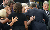 United States President Barack Obama and first lady Michelle Obama comfort families of the victims at a memorial for the victims of the Washington Navy Yard shooting at the Marine Barracks, September 22, 2013 in Washington, D.C.  The President and first lady also visited with families of the victims. <br /> Credit: Olivier Douliery / Pool via CNP