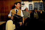Farmers and countrymen gather at the Kings Head, and also know as the Low House pub, in  Laxfield Suffolk, UK.  Traditional story telling, reciting of poetry and folk music songs are performed in an informal manner every Sunday morning.