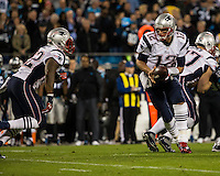 The Carolina Panthers play the New England Patriots at Bank of America Stadium in Charlotte North Carolina on Monday Night Football.  The Panthers defeated the Patriots 24-20.  New England Patriots quarterback Tom Brady (12), New England Patriots running back Stevan Ridley (22)