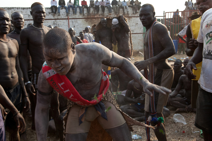 Sunday 5 december 2010 - Juba, Southern Sudan - Mundari wrestlers before the match. Traditional wrestling matches in Juba Stadium between Dinka wrestlers from Yirol East of Lake State and Mundari wrestlers from Terekeka County of Central Equatoria State. The matches attracted large numbers of spectators who sang, played drums and danced in support of their favorite wrestlers. The match organizers hoped that the sport would bring together South Sudan's many different tribes.Photo credit: Benedicte Desrus