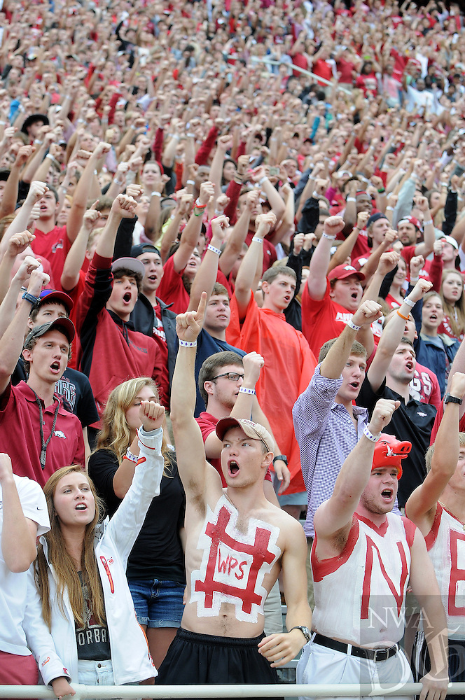 STAFF PHOTO ANTHONY REYES • @NWATONYR<br /> Fans cheer as the Razorbacks score a touchdown against Nicholls State in the first quarter Saturday, Sept. 6, 2014 at Razorback Stadium in Fayetteville.