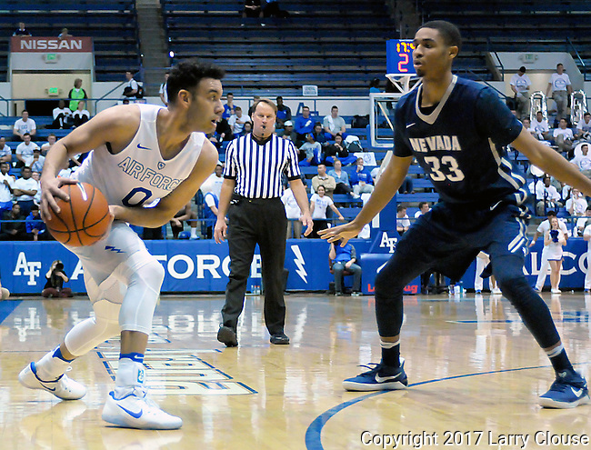 February 15, 2017:  Air Force guard, Caleb Morris #0, looks to make a pass during the NCAA basketball game between the University of Nevada Wolfpack and the Air Force Academy Falcons, Clune Arena, U.S. Air Force Academy, Colorado Springs, Colorado.  Nevada defeats Air Force 78-59.