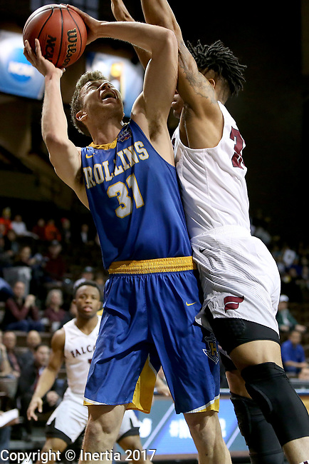 SIOUX FALLS, SD: MARCH 22: Sam Philpott #31 from Rollins is fouled while taking the ball to the basket by Troy Cantrell #34 from Fairmont State during the Men's Division II Basketball Championship Tournament on March 22, 2017 at the Sanford Pentagon in Sioux Falls, SD. (Photo by Dave Eggen/Inertia)