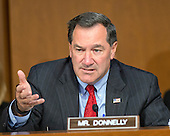 United States Senator Joe Donnelly (Democrat of Indiana) questions U.S. Secretary of Defense Chuck Hagel and Chairman, Joint Chiefs of Staff General Martin E. Dempsey, U.S. Army, as they deliver testimony before the U.S. Senate Committee on Armed Services on the U.S. policy towards Iraq and Syria and the threat posed by the Islamic State of Iraq and the Levant (ISIL) in Washington, D.C. on Tuesday, September 16, 2014.<br /> Credit: Ron Sachs / CNP
