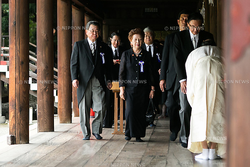 A group of lawmakers follow a Shinto priest to pay their respects to the war dead at Yasukuni Shrine on the 71st anniversary of Japan's surrender in World War II on August 15, 2016, Tokyo, Japan. Some 70 lawmakers visited the Shrine to pay their respects, but the Prime Minister Shinzo Abe did not visit the controversial symbol and instead sent a ritual offering to a shrine. Yasukuni enshrines the war dead including war criminals and as such visits by Japanese  politicians tend to provoke anger from neighbors China and Korea that suffered from Japan's militarist past. (Photo by Rodrigo Reyes Marin/AFLO)