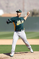 Gio Gonzalez #47 of the Oakland Athletics pitches a live batting practice session in spring training workouts at the Athletics complex on February 23, 2011  in Phoenix, Arizona. .Photo by:  Bill Mitchell/Four Seam Images.