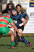 Steven Jones looks to avoid Fuifatu Asomua as he brings the ball forward. Counties Manukau Premier Club Rugby game between Onewhero and Waiuku, played at Onewhero on Saturday May 26th 2018. Onewhero won the game 24 - 20 after leading 17 - 12 at halftime. <br /> Onewhero Silver Fern Marquees 24 -Vaughan Holdt, Filipe Pau, Sean Bagshaw tries, Rhain Strang 3 conversions, Rhain Strang penalty.<br /> Waiuku Brian James Contracting 20 - Christian Walker, Fuifatu Asomua, Aaron Yuill tries, Christian Walker conversion, Christian Walker penalty .<br /> Photo by Richard Spranger.
