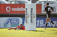 Welsh out half Gareth Owen scores during the Division A clash against New Zealand at Ravenhill. Result New Zealand 37 Wales 14.
