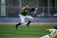 Siena Saints second baseman Jordan Bishop (4) jumps to catch a throw as Ryan Crile (7) slides in during a game against the UCF Knights on February 21, 2016 at Jay Bergman Field in Orlando, Florida.  UCF defeated Siena 11-2.  (Mike Janes/Four Seam Images)
