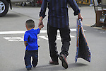 Hispanic father walks with his son in Denver, Colorado. .  John offers private photo tours in Denver, Boulder and throughout Colorado. Year-round Colorado photo tours.