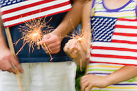 Fourth of July Celebration with Sparklers and the American Flag.