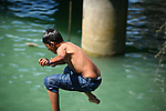 CHILD JUMPS IN WATER OFF PIER (3)