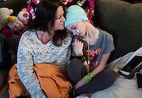 Pam Christie hugs her daughter, Cassidy, 10, who is battling cancer Wednesday, Feb. 18, at home in Bangor Township.<br /> (Yfat Yossifor | The Bay City Times)