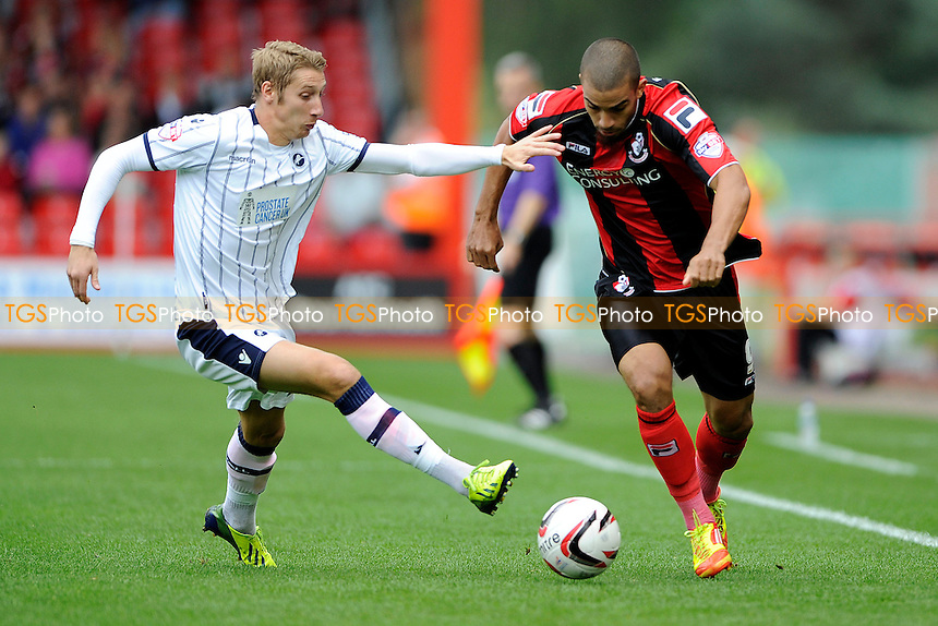 Lewis Grabban of AFC Bournemouth goes round Lee Martin of Millwall - AFC Bournemouth vs Millwall - Sky Bet Championship Football at the Goldsands Stadium, Bournemouth, Dorset - 05/10/13 - MANDATORY CREDIT: Denis Murphy/TGSPHOTO - Self billing applies where appropriate - 0845 094 6026 - contact@tgsphoto.co.uk - NO UNPAID USE