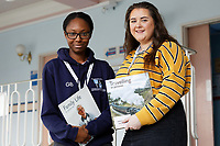 Pictured L-R: Gail Bortey, 22, who studies Applied Medical Science with organiser Megan Frost, 21, a law student. Wednesday 27 November 2019<br /> Re: Christmas appeal story, volunteers read books to some of the elderly patients at Singleton hospital in Swansea, Wales, UK.