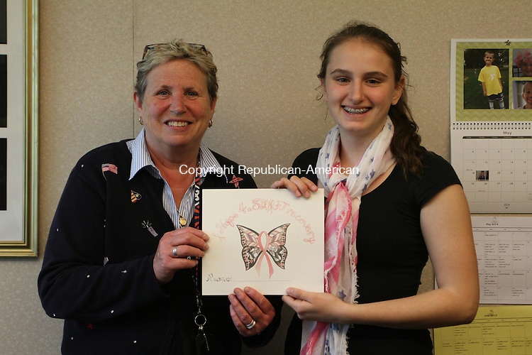 WATERTOWN, CT May 30 2014-053014LW01 - Watertown's Swift Middle School Assistant Principal Mary Jean Mangione, left, poses with eight grade student Diana Ghisa. Ghisa created a butterfly design with a pink breast cancer ribbon in the center in honor of Mangione, who was diagnosed with breast cancer about a year ago. Ghisa made copies of the design and sold it to her classmates for $1. The students donated over $200 to Relay for Life and breast cancer research. The students wrote their names on the bottom of each image and displayed them in the school's lobby when Magione returned in January. &quot;It was very touching and welcoming,&quot; Mangione said. She said she is doing much better now and is working toward getting back to work full time.<br />