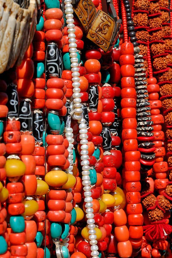 Amdo beads, necklaces and jewelry at market stall, Barkhor Square, Lhasa, Tibet.