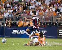Houston Dynamo defender Patrick Ianni (4) slide tackles CD Guadalajara midfielder Edgar Solis (16).  CD Guadalajara defeated Houston Dynamo 1-0 during the group stage of the Superliga 2008 tournament at Robertson Stadium in Houston, TX on July 15, 2008.