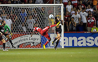 Chicago Fire forward Patrick Nyarko (14) kicks AC Milan defender Luca Antonini (77) in the head while attempting a bicycle kick.  AC Milan defeated the Chicago Fire 1-0 at Toyota Park in Bridgeview, IL on May 30, 2010.