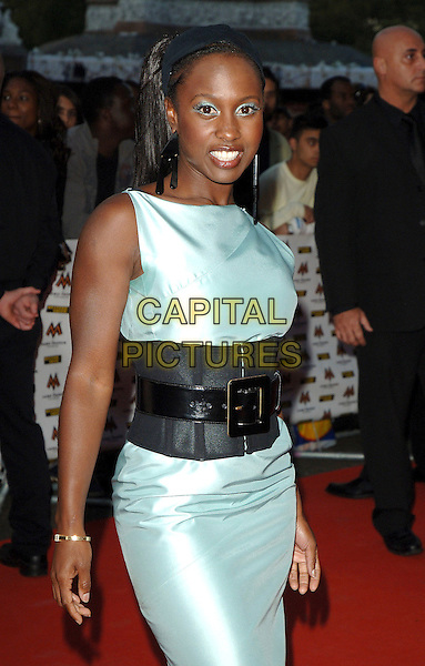 MICHELLE GAYLE.attending the 2006 MOBO Awards, Royal Albert Hall, London, England, 20th September 2006..half length turquoise eyeliner eyeshadow make-up hair band black hairband silk satin dress black waist cincher belt.Ref: BEL.www.capitalpictures.com.sales@capitalpictures.com.©Tom Belcher/Capital Pictures.