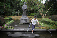 """A young boy within the grounds of the Dujiangyan Irrigation System. The system is regarded as an """"ancient Chinese engineering marvel."""" By naturally channeling water from the Min River during times of flood, the irrigation system served to protect the local area from flooding and provide water to the Chengdu basin. Sichuan Province. 2010"""