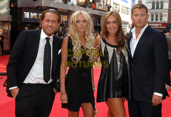 """GUEST, PETRA ECCLESTONE, TAMARA ECCLESTONE & GUEST .Attending the UK Premiere for the new Batman movie """"The Dark Knight"""", Odeon Leicester Square, London, England,.July 21st 2008..half length black suits dresses dress sisters family .CAP/WIZ.©Wizard/Capital Pictures"""