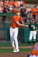 Relief pitcher Ryan Miller (35) of the Clemson Tigers throws to first in a game against the William and Mary Tribe on February 16, 2018, at Doug Kingsmore Stadium in Clemson, South Carolina. Clemson won, 5-4 in 10 innings. (Tom Priddy/Four Seam Images)