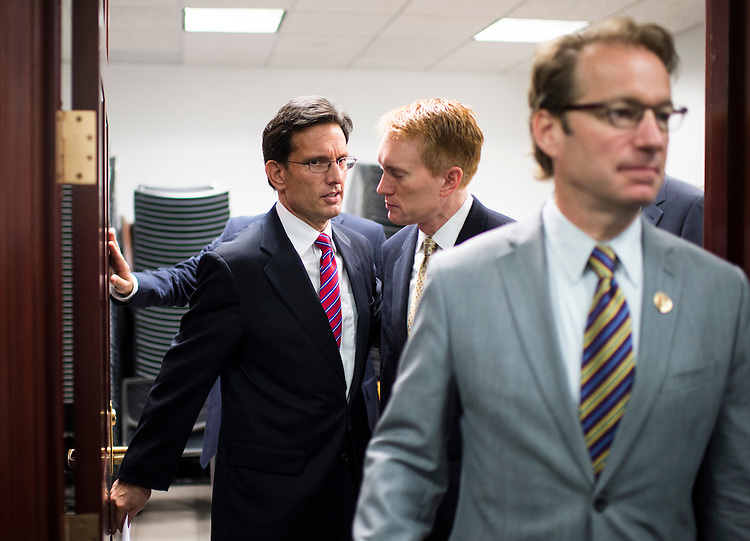 UNITED STATES - OCTOBER 4: From left, House Majority Leader Eric Cantor, R-Va., Rep. James Lankford, R-Okla., and Rep. Peter Roskam, R-Ill., leave the House Republican Conference meeting in the basement of the Capitol on Friday, Oct. 4, 2013.  (Photo By Bill Clark/CQ Roll Call)