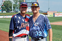 Quad Cities River Bandits left fielder Seth Beer (35) poses for a photo with Clemson teammate and West Michigan Whitecaps pitcher Clate Schmidt (32) after a game against the West Michigan Whitecaps on July 23, 2018 at Modern Woodmen Park in Davenport, Iowa.  Quad Cities defeated West Michigan 7-4.  (Mike Janes/Four Seam Images)