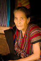 Elderly Laotian selling textiles at cultural center on Bolaven Plateau,Laos
