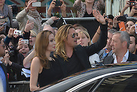 Angelina Jolie, Brad Pitt<br /> 'World War Z' world premiere, Empire cinema, Leicester Square, London, England 2nd June 2013 <br /> half length black dress suit sunglasses shades goatee facial hair couple hand arm in air waving mouth open profile<br /> CAP/PL<br /> &copy;Phil Loftus/Capital Pictures /MediaPunch ***NORTH AND SOUTH AMERICAS ONLY***