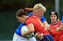 BELFAST, NORTHERN IRELAND - AUGUST 26: Spain's Maria Ribera tackles Italy's Flavia Severin during a final play off  in the Women's World Cup Rugby 2017 at Queen's  University Belfast, Saturday,  August 26, 2017. Photo/Paul McErlane