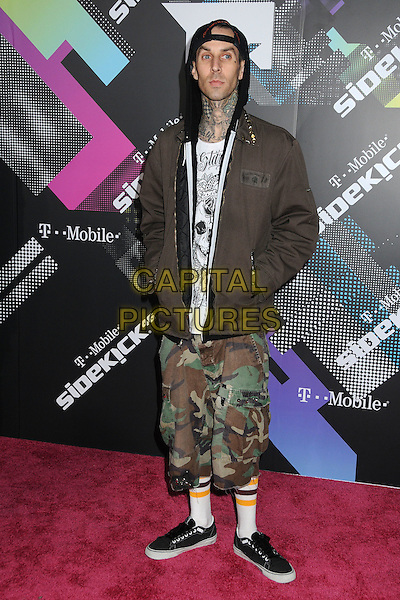 TRAVIS BARKER.The T-Mobile Sidekick 4G Launch Party held at a private lot in Beverly Hills, California, USA..April 20th 2011.full length brown coat hood up cap hat socks trainers black green camouflage .CAP/ADM/BP.©Byron Purvis/AdMedia/Capital Pictures.