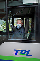 "Switzerland. Canton Ticino. Lugano. Railway station. Bus stop.  A bus driver wears a mask on the face to protect himself from Coronavirus (also called Covid-19). TPL is the public transport company that serves the city of Lugano and the neighbouring municipalities. Due to the spread of the coronavirus, the Federal Council has categorised the situation in the country as ""extraordinary"". It has issued a recommendation to all citizens to stay at home, especially the sick and the elderly. The Federal Council (German: Bundesrat, French: Conseil fédéral, Italian: Consiglio federale, Romansh: Cussegl federal) is the seven-member executive council that constitutes the federal government of the Swiss Confederation. From March 16 the government ramped up its response to the widening pandemic, ordering the closure of bars, restaurants, sports facilities and cultural spaces. Only businesses providing essential goods to the population – such as grocery stores, bakeries and pharmacies – are to remain open. 27.03.2020 © 2020 Didier Ruef"
