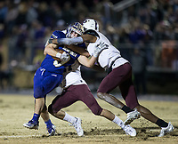 NWA Democrat-Gazette/BEN GOFF @NWABENGOFF<br /> Trey Rucker (left) and Ryan Johnson, Prescott defenders, tackle Cam Brasher of Booneville as he runs the ball in the second quarter Saturday, Dec. 1, 2018, during the class 3A state semifinal game at Bearcat Stadium in Booneville.