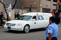 Phoenix, Arizona. July 7, 2013 - Nineteen hearses for each of the fallen members of the Granite Mountain Hotshots Arizona firefighting crew who died last week formed a procession to honor them in Phoenix as their bodies were taken back home to Prescott, about an 80-mile route. This hearse carries the remains of firefighter Travis Carter. Photo by Eduardo Barraza © 2013